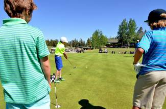 A group of older students with the PGA Junior League program at Keystone Golf Club play a putting game on the practice green in June. The program covers all elements of the game during coaching sessions before players compete in up to five in-house tournaments.