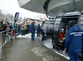 Skier and snowboarders load into River Run Gondola at Keystone for opening day on Nov. 6.