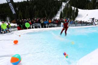 A pond-skimmer edges closer and closer to dry land (or snow) during the 2014 Slush Cup at Keystone. The annual event returns to close the season on April 10, with skimming beginning at 11 a.m. near the Mountain House base area.