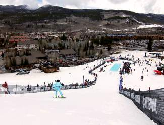 A view of the run-in to the pond-skimming pond at the Mountain House base area in Keystone. The annual event pits snowboarders and skiers against a, uh, pit filled with frigid water. The goal: make it to the other side as dry as possible.