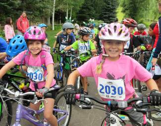 Dylan Stepanek (left) and Kylie Kirkham prepare for the bike leg of the Kids Adventure Games at Vail Mountain in 2015. The event expands to Copper Mountain this year with the Copper Family Adventure Quest, which gives parents and kids the chance to team up for adventure race obstacles from July 1-2.