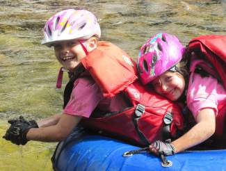 Young Kylie Kirkham (left) and Dylan Stepanek raft down Gore Creek with nothing but a tube and smiles during the Kids Adventure Games at Vail Mountain in 2015. The event expands to Copper Mountain this year with the Copper Family Adventure Quest, which gives parents and kids the chance to team up for adventure race obstacles from July 1-2.