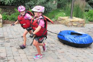 Vail's Dylan Stepanek (left) and Kylie Kirkham port their raft from location to location during the Kids Adventure Games at Vail Mountain in 2015. The event expands to Copper Mountain this year with the Copper Family Adventure Quest, which gives parents and kids the chance to team up for adventure race obstacles from July 1-2.