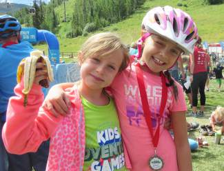 Youngsters Dylan Stepanek (left) and Kylie Kirkham refuel at the end of the Kids Adventure Games at Vail Mountain in 2015, a three-mile fun race that pits youth competitors against climbing walls, bike trails and local rivers. The event expands to Copper Mountain this year with the Copper Family Adventure Quest, which gives parents and kids the chance to team up for adventure race obstacles from July 1-2.