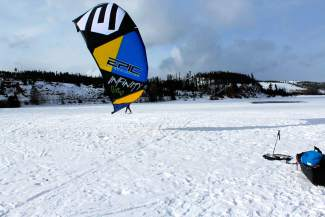 A snow-kite sail catches wind on the southern edge of Lake Dillon.