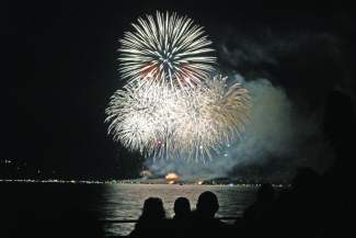 The Fourth of July fireworks are seen from Regan Beach in Lake Tahoe. A Clean Water Act lawsuit filed by two residents of Pine Wild in Marla Bay may force the Lake Tahoe Visitors Authority to pull the plug on its Fourth of July and Labor Day fireworks shows.