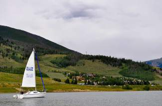 A sailboat piloted by Bob Evans of the Dillon Marina passes in front of Tenderfoot Mountain on a July afternoon.