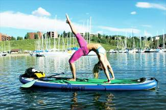 One of the unique adventures out of Dillon is stand-up paddleboard yoga. Right now, the majority of summer activities at DIllon and Frisco Bay are on hold until ice melts fully at the docks.