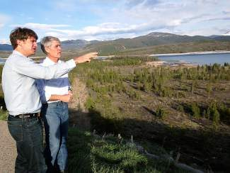 Summit County Commissioner Dan Gibbs, foreground, and former U.S. Sen. Mark Udall, (D-Colorado) in 2014 when they visited the Lake Hill property that the county is now in the process of buying from the U.S. Forest Service for workforce housing development.