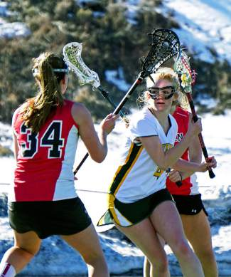 Time for one shot: Elle Scott-Williams eyes a goal for the Lady Tigers lacrosse team just as Aspen defenders close in during a home game last week, shot by @louietraub