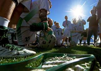 The Summit boy's varsty lacrosse team takes a knee during halftime of a game against Eagle Valley at home on April 6. The Tigers lost, 7-9, after entering the half ahead by three, 6-3.
