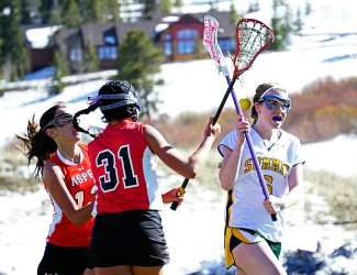 Ball down: Summit senior Siena Fowles (12) loses the ball just as she's swarmed by Aspen players at a home varsity lacrosse game in early April, shot by @louietraub
