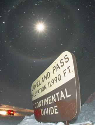 The full moon finally breaks free from clouds at the top of Loveland Pass on Christmas night, Dec. 25.