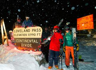 Skiers and snowboarders get in the spirit with lights at the top of Loveland Pass on Christmas night, Dec. 25. Rouhgly 40 people came to ski under a full moon that kept peeking in and out of thick snow clouds.