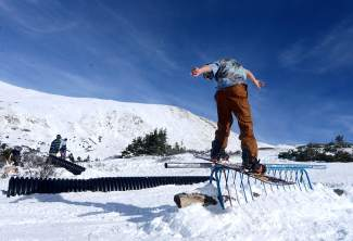 Chance Tinkham, 21, locks into a frontside noseslide on a rail at Loveland Pass on Oct. 25. About 20 locals gathered at the top of the pass for a few days of pre-season jibbing after the first major snowstorm of the season.