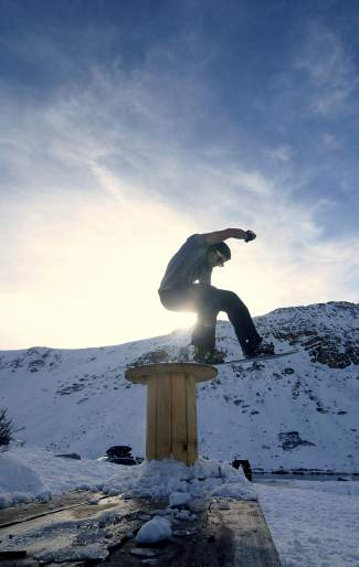 Evan Hannibal of Breckenridge bonks a wooden axle on a picnic table near the top of Loveland Pass on Oct. 25. Roughly 20 locals came to the pass for an afternoon rail session after the first snowstorm of the season last week.