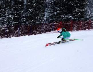 A Loveland Ski Club racer crashes the gates during late-season training in 2015. This June, Loveland Ski Club pairs with DU skier Sebastian Brigovic for a two-week technical camp made for U-10 to U-14 skiers.