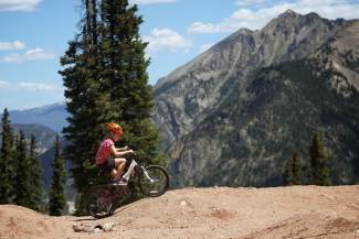 A young rider on one of several high-alpine trails and pump tracks at Copper. The resort's on-mountain trail network plays host to the brand-new Copper Crush mountain bike races on July 30.