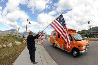 A statewide procession for the fallen Flight for Life pilot Patrick Mahany arrives in Frisco on Thursday.