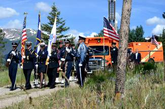 A processional makes its way down a dirt road to the stage of the Dillon Amphitheater at the memorial service for Patrick Mahany on Friday. Mahany, a Flight for Life helicopter pilot, died in a crash in Frisco on July 3.