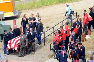 Patrick Mahany's casket was draped in an American flag, in honor of his military service and patriotism.