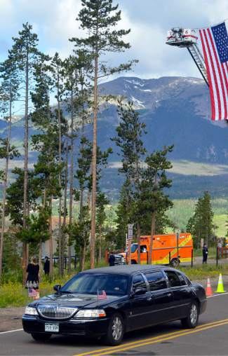 Summit County Boy Scout troops lined the streets leading up to the Dillon Amphitheater, bearing the stars and stripes as the EMS procession approached.