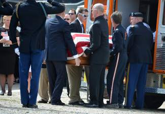 Patrick Mahany's casket is carried to a memorial service in Dillon on Friday.