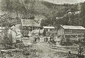 This 1909 photograph shows Masontown at its height. The mill in the background was the town's driving force. At one point the town consisted of the mill, twelve lode claims and one placer claim. There were also 10-12 cabins, including a bunkhouse.