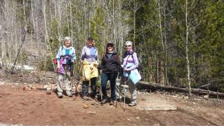Members of the tour group stand on a cabin foundation, one of few remains from Masontown. From left: Becky, Sandy, Carol and Lorle. Carol was visting from Colorado Springs, while Becky, Sandy and Carol are all members of Summit County Senior Citizens.