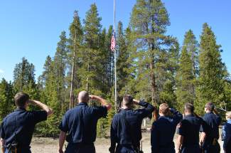Local first responders salute the flag during a Memorial Day commemoration ceremony at Valley Brook Cemetery in Breckenridge on Monday, May 30.