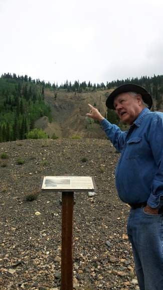 Bill Fountain gestures to the hillside near the Wire Patch Mine showing the wear and tear of hydraulic mining.