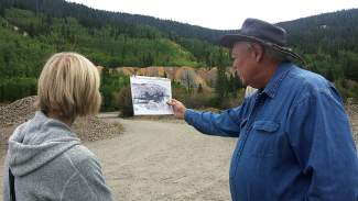Kris Ann Knish looks on as Bill Fountain explains the expansive tunnel system that makes up the Wellington Mine, the longest mine in Summit.