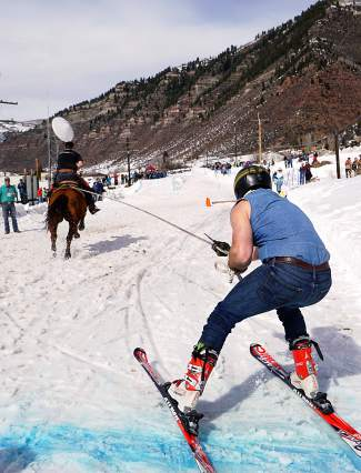 Skiers, horses and riders compete in a skijoring competition: The team takes a run down an 800-foot course with jumps, pylons and rings to collect for points. The competition continues today at noon in downtown Minturn.