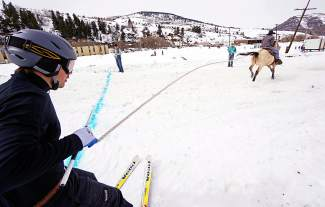 In a skijoring competition, horses with riders pull a lone skier in excess of 35 mph through a course with pylons, rings and jumps. The goal: get from start to finish the fastest. The reward: cash money and bragging rights.