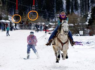 A skijoring team weaves through a course on Main Street in Minturn Feb. 27.