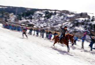 A skijoring team cruise by a crowd on Main Street Minturn during an event on Feb. 27.