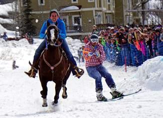 Skijoring competitors are towed by a horse at 35 mph while navigating a course over jumps and around pylons, all while collecting rings with an old ski pole.
