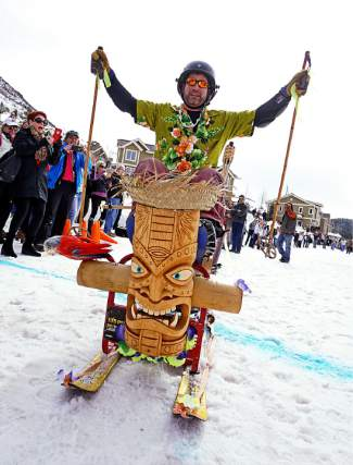 Locals take part in the barstool race at the RMX Skijoring event in Minturn. For the barstool race, folks mount skis onto a stool and get pushed down a small hill.