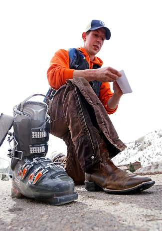 Skijoring newcomer James Otteman swaps out his cowboy boots for ski boots before the Minturn RMX competition on Saturday, Feb. 27.