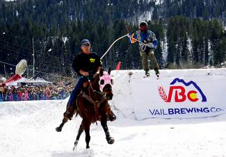 Bruce Stott, right, is towed by Tim McCarthy riding Moose through a skijoring course during a competition in Minturn Feb. 27.