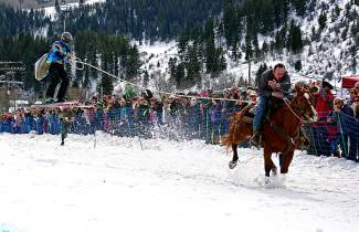 Skijoring competitors take a run down a course with skier, horse and rider in Minturn on Feb. 27.