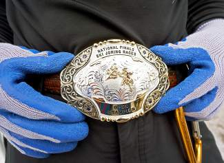 A skijoring competitor shows off his belt buckle before the start of races in Minturn Feb. 27.