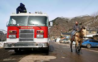 A horse walks back past a fire engine during the skijoring competition in Minturn on Feb. 27.