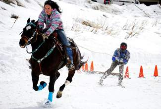 Frisco resident and 16-year skijoring veteran Bruce Stott (on skis) gets towed through a skijoring course by Savannah McCarthy riding her horse, Tank. The trio took second on Day 1 of the open competition at the Minturn RMX Skijoring competition on Feb. 27 with a time of 15.62 seconds.