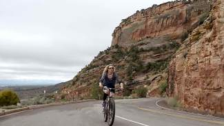 Host Shawna Henderson pedals up one of several roads in Colorado National Monument, a stunning collection of natural rock formations on the Western Slope. The Monument is closed to mountain biking but perfect for road cyclists.