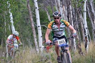 Summit bike team co-captain  Liam McDonnell pushes uphill during the Snow Mountain Ranch Stampede in Granby earlier this month.