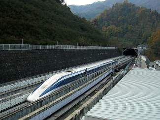 A High-Speed Maglev train speeds out of a tunnel on a test track in the Yamanashi Prefecture in Japan. A team of consultants and state transportation officials are currently studying the feasibility of constructing a similar high-speed transit system in Colorado.