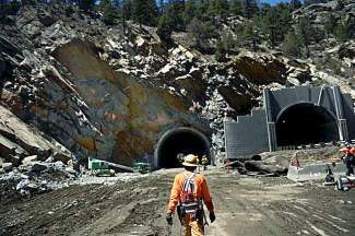IDAHO SPRINGS, CO. - May 03: A worker heads to his side of the tunnel at the east portal of the Twin Tunnels project in Idaho Springs. The project has shifts working 24 hours a day 6 days a week and the crews are tunneling from both ends May 03, 2013 Idaho Springs, Colorado. (Photo By Joe Amon/The Denver Post)