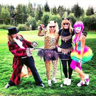 Cathy Boland, Samantha Knipp, Traci O'Connor and Melanie Parrish clown around in their circus costumes at the 2013 Fatty's Golf Tournament.