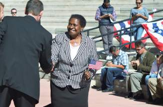 Melissa Rogers Malumbe is congratulated by Andy Lambrecht with U.S. Citizenship and Immigration Service after becoming a naturalized U.S. citizen on October 8.